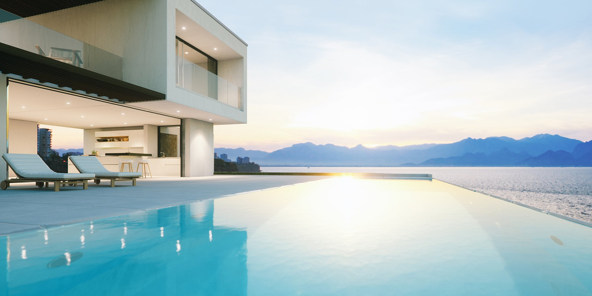 Sunrise on an Infinity Pool with Mountains on the Horizon