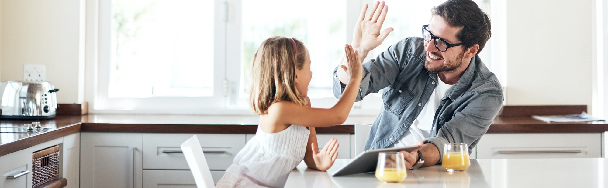 Father and daughter high five